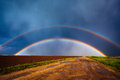 Double rainbow over field Royalty Free Stock Photo