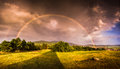Double rainbow over landscape at sunset with city of nitra in background Stock Images