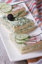 Double sandwiches with soft cheese, cucumbers, radishes vertical Royalty Free Stock Photo