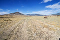 Double track gravel road that doesn t get much traffic heading towards distant nevada mountains Stock Photos
