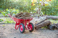 Double wheel barrow carrying wood Royalty Free Stock Photo