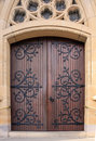Double wooden church doors set in sandstone archway Royalty Free Stock Photo