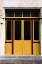 Double yellow and glass doors Royalty Free Stock Photo