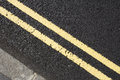 Double yellow lines focused shot on Stock Image