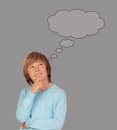Doubtful preteen boy thinking on gray background Stock Photos