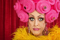 Doubting drag queen with wig frowning in theater Royalty Free Stock Image