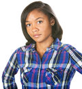 Doubting young woman in flannel shirt over isolated background Stock Photos