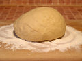 Dough ball of on wooden board ready to be baked Royalty Free Stock Image