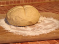 Dough ball of on wooden board ready to be baked Royalty Free Stock Images