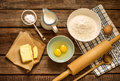 Dough recipe ingredients on vintage rural wood kitchen table baking cake in eggs flour milk butter sugar and rolling pin from Stock Images