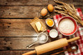 Dough recipe ingredients on vintage rural wood kitchen table baking cake in eggs flour milk butter sugar wooden from above Stock Photos