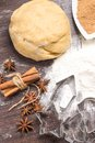 Dough with spices and cookie cutters of gingerbread Royalty Free Stock Images
