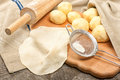 Dough for tortillas raw made from wheat flour on the wooden table Royalty Free Stock Photos
