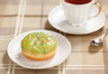 Doughnut and cup of tea Stock Photos