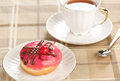 Doughnut and cup of tea closeup Royalty Free Stock Photo