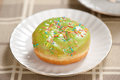 Doughnut on a plate close up Stock Image