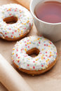 Doughnuts and cup of tea Royalty Free Stock Photo