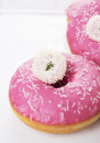 Doughnuts with pink glaze and white flowers Stock Image
