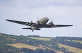 Douglas c dakota with d day markings fort george scotland august flying on august over fort george scotland over s were built and Royalty Free Stock Photos