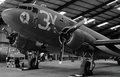 Douglas c skytrain dakota aircraft with d day invasion stripes or parked in a hangar painted the was used extensively Stock Photography