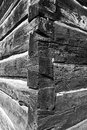 Dovetail log cabin joint this is a black and white image of the corners on a vintage square Royalty Free Stock Photo