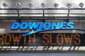 Dow jones news ticker a in times square new york city company is a publishing and financial information firm Stock Photos