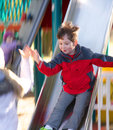 Down the slide little boy sliding at park with motion blur Royalty Free Stock Image