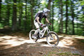 Downhill mountain bikers Stock Photos