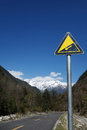 Downhill road sign in the mountains Royalty Free Stock Images