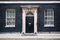 Entrance door of 10 Downing Street in London, UK Royalty Free Stock Photo