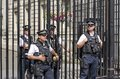 Downing street security guards at the gates to number residence of the british prime minister in london england Stock Photo