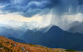 Downpour heavy in spring mountains Stock Photo