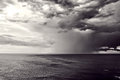 Downpour with stormy clouds over sea Royalty Free Stock Photography