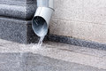 Downspout in heavy rain Royalty Free Stock Photo