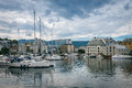Downtown alesund norway july overcast day in yachts in the harbor Royalty Free Stock Images