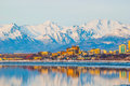 Downtown anchorage alaska and its reflection into cook inlet Stock Photos