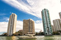 Downtown Miami along Biscayne Bay with condos and office buildings, yacht sailing in the bay Royalty Free Stock Photo