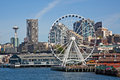 Downtown seattle waterfront and the great wheel clear blue sky day in washington on with space needle ferris Stock Photos