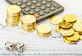Downtrend stacks golden coins dices cubes words sell buy calculator financial stock charts selective focus Royalty Free Stock Photography