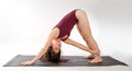Downward facing dog variation an image of a woman in a twist of the yoag pose Stock Images