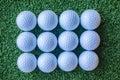 Dozen new golf balls turf Royalty Free Stock Photography