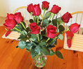 A Dozen Red Roses in a Crystal Vase Stock Photo