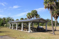 Dozen wood picnic tables covered open building hugh taylor birch state park fort lauderdale florida surrounded grass palm other Royalty Free Stock Images