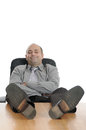 Dozing businessman dreaming of good times Royalty Free Stock Images