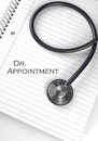 Dr appointment text on a notepad with a stethoscope Royalty Free Stock Image