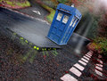 Dr who tardis and aliens somewhere in a quiet kent country lane the time machine arrives on earth only to be confronted with from Stock Image