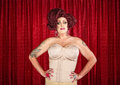 Drag queen in corset with hands on hips Stock Image