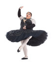 Drag queen dancing in a tutu overweight nimbly balancing on tiptoe with his foot raised fun caricature of female ballet Royalty Free Stock Image