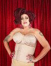 Drag queen in girdle big confident with hands on hips Stock Images