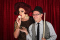 Drag queen kissing cue ball cross dressing men with smiling friend Royalty Free Stock Image
